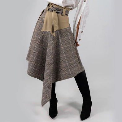 Asymmetrical plaid midi skirt in black and beige tones, belted high waist and a gently flared silhouette.