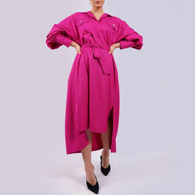Relaxed silhouette knee-high pink shirt dress with drop shoulders, ballooned sleeves, button cuffs and back pleated details.