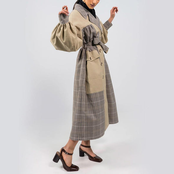 Beige and plaid trench coat oversized silhouette with calf-grazing length, dropped shoulders, oversized sleeves, gathered chest, shirt cuffs and patch pockets.
