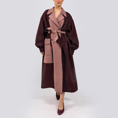 Bordeaux and pink trench like coat with oversized silhouette with calf-grazing length, dropped shoulders, oversized sleeves, gathered chest, shirt cuffs and patch pockets.
