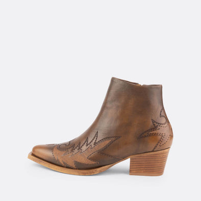 Brown leather western ankle boots with aztec engravings.