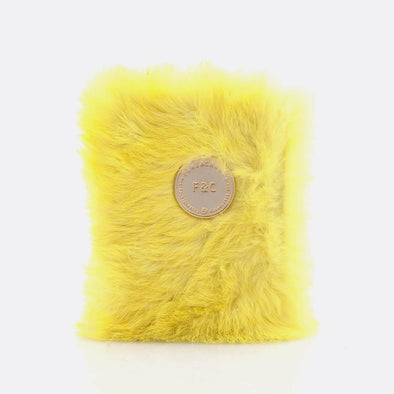 A6 notebook with 160 plain pages and yellow furry leather cover.