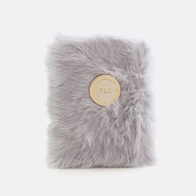 A6 notebook with 160 plain pages and light grey furry leather cover.