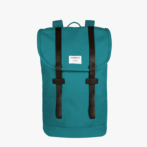 Minimalist petrol-blue canvas backpack with two black leather buckle straps