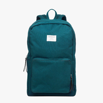 Minimalist backpack in monochromatic petrol blue with exterior pocket and matching zippers