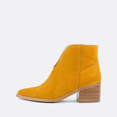 Yellow crute ankle boots with wooden heel.