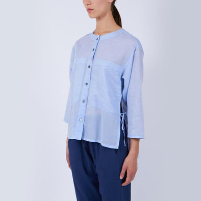 Light blue round neck blouse made of a lightweight cotton-linen blend.