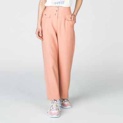 Soft pink high waisted button down trousers.