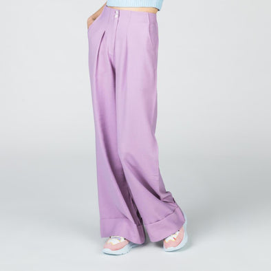 Lilac wide leg trousers featuring an oversized cuff turn up and pockets.
