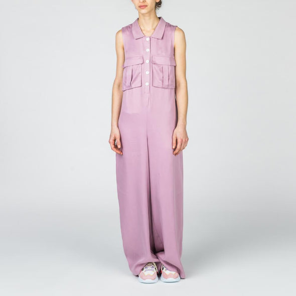 Lilac wide leg jumpsuit with white buttons and front pockets.