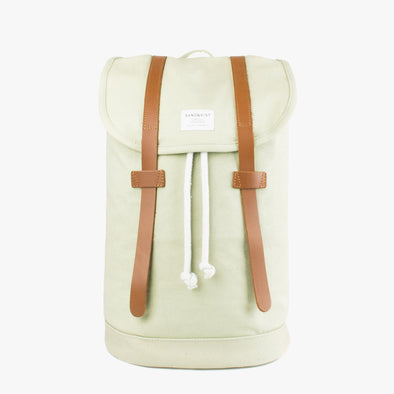 Minimalist lime green canvas backpack with two brown leather buckle straps