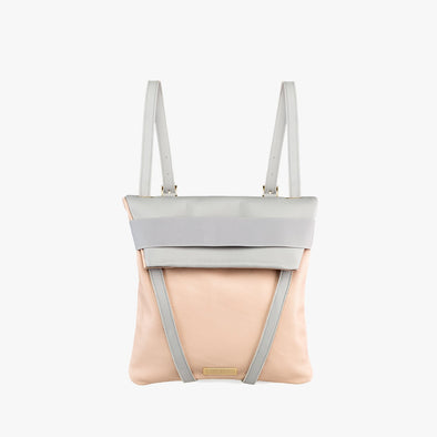 Faceted reversible backpack in nude and light grey leather with fold-top, brown leather straps and light grey elastic closure