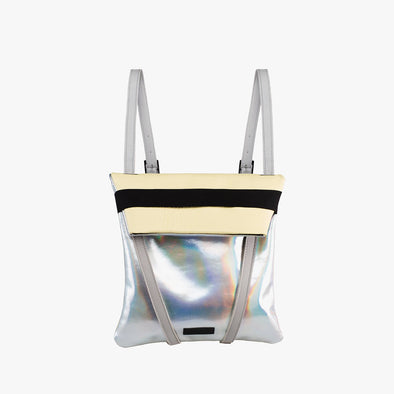Faceted reversible backpack in pale yellow leather and silver holographic leather with fold-top and elastic