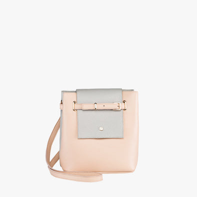 Bucket-style faceted mini bag in nude and light blue leather with fold flap and buckle strap that can be adjusted