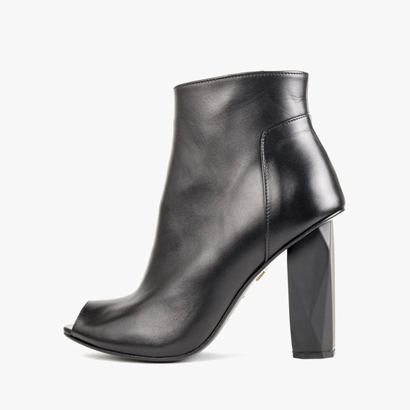 Black ankle boots in leather with a peep toe and faceted high heel