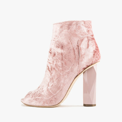 Rose pink ankle boots in velvetwith a peep toe and faceted high heel
