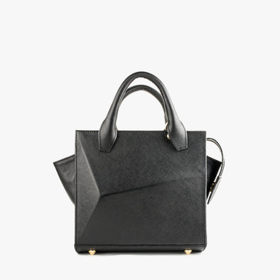 Small handbag in black leather with faceted design and removable shoulder strap