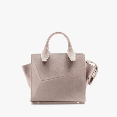 Small handbag in nude leather with faceted design and removable shoulder strap