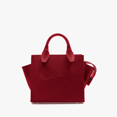 Small handbag in red leather with faceted design and removable shoulder strap