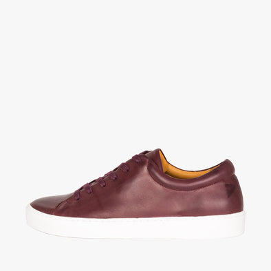 Lace-up sneakers in bordeaux leather with white rubber sole