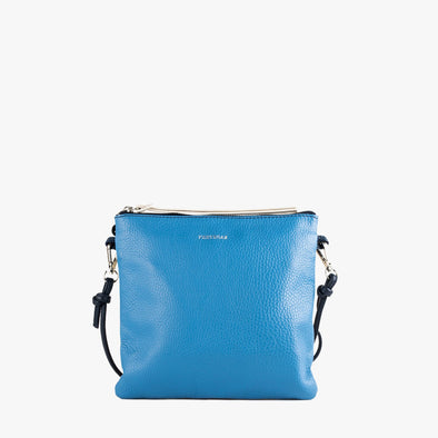 Rectangular shoulder bag with front panel in off-white and back panel in blue with thin dark blue shoulder strap