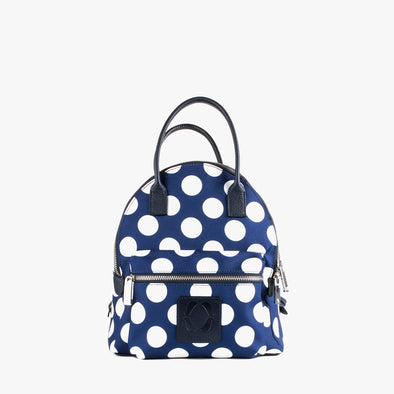 Mini backpack in dark blue textile with large white polka dots, exterior pocket, shoulder straps and handle