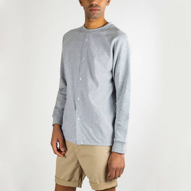 Grey distinct shirt/sweatshirt combo.