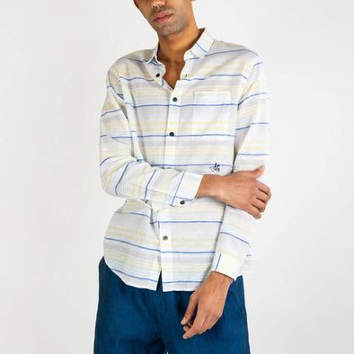 White long sleeved shirt with blue and yellow stripes and black buttons.