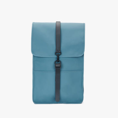 Boxy minimalist backpack in pacific blue synthetic with a single metallic black hook clasp
