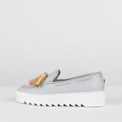Platform loafers in baby blue leather with three tassels and white platform dented sole