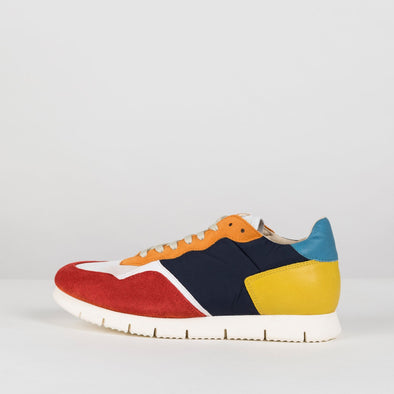 Runners in paneled combination of red, white and orange suede, navy blue fabric and yellow and blue leather