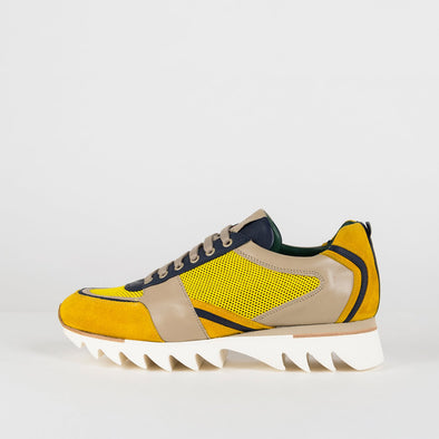 Man's bold yellow and navy sneakers with a beige leather detail.
