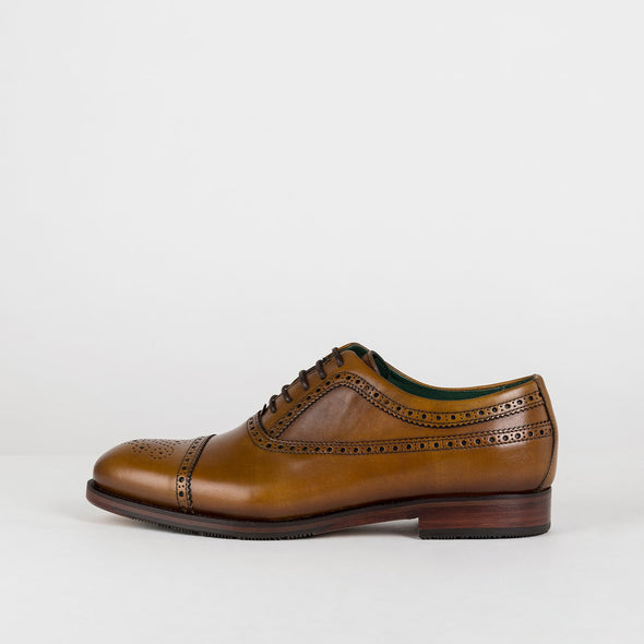 Man's brown polished leather oxford shoes with perfuration details.