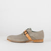 Man's classy grey suede monk shoes with a beige strap.