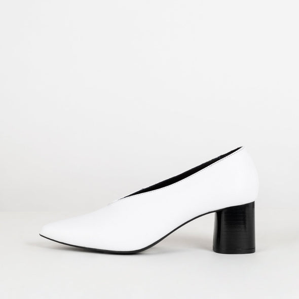 White leather pumps with black heel.
