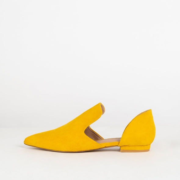 Yellow suede open flat shoes with pointed toe.