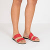 Double-strap flat red leather sandals.