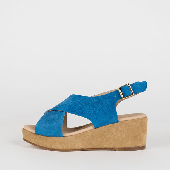 Platform sandals with a cross-strap in electric blue suede.