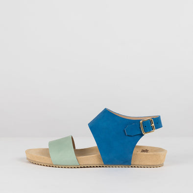 Sandals in leather with one cobalt blue strap that buckles in the ankle and a soft blue strap