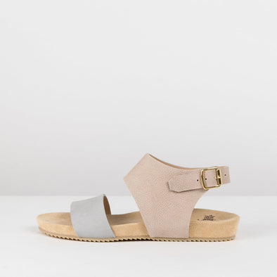 Sandals in leather with one beige strap that buckles in the ankle and a grey strap
