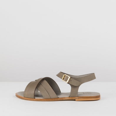 Cross-strap sandals in military green leather with ankle buckle