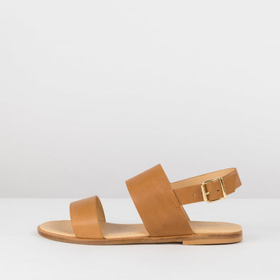 Double-strap sandals in camel brown leather with ankle buckle