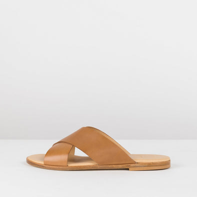 Simple slide sandals in a cross-strap design in camel brown leather