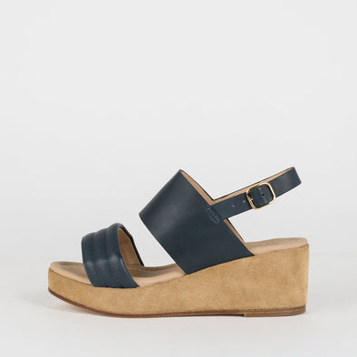 Platform sandals with a double-strap in navy blue leather.
