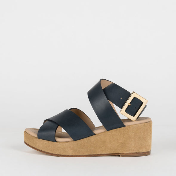 Platform sandals with a cross-strap in navy blue leather.