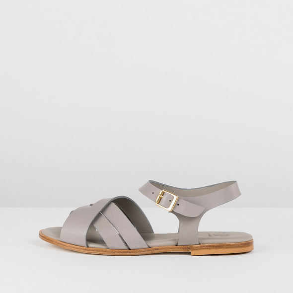 Cross-strap sandals in grey leather with ankle buckle