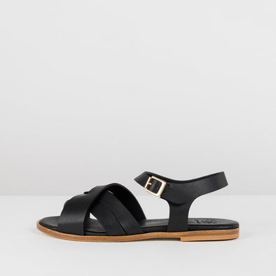 Cross-strap sandals in black leather with ankle buckle