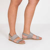 Double-strap sandals in grey leather with ankle buckle