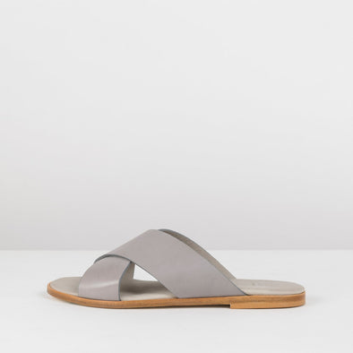 Simple slide sandals in a cross-strap design in grey leather