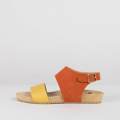 Sandals in leather with one orange strap that buckles in the ankle and a yellow strap